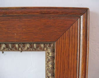 Antique oak Picture Frame with ornate boarder