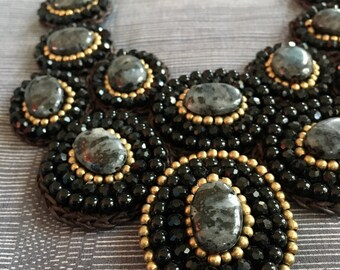 Black set of gem and brass beads crochet necklace