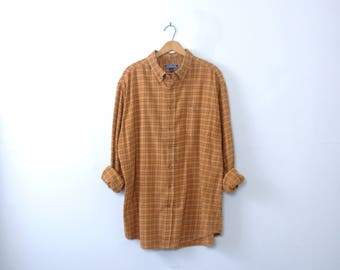 Vintage 90's grunge pumpkin orange plaid flannel shirt, size XL tall / long