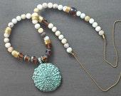 Long Beaded Boho Necklace with Metal Sea Urchin Patina Pendant