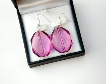 Purple acrylic beaded dangle and drop earrings made with platinum earring wires and silver plated eye pins.