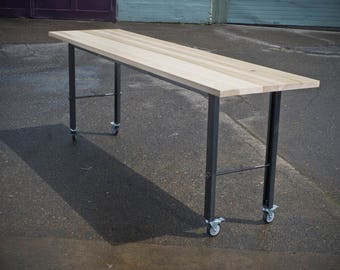 Tall communal table on casters
