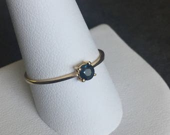 Gorgeous vintage 14k yellow gold faceted round sapphire solitaire ring.