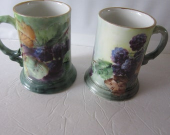 french steins,,handpainted berries, limoge china.gorgeous pair of steins