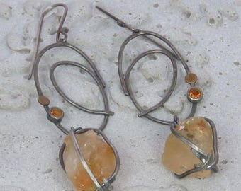 Rough citrines hanging from silver scribbles