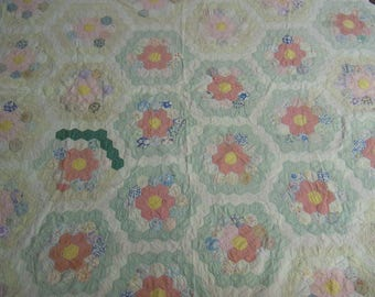 """Vintage quilt grandmother's flower garden 1930s  hand pieced and quilted  72"""" x 90"""" cotton scraps  muted colors"""