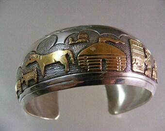 Vintage Begay Navajo Signed Storyteller Bracelet in Sterling and Gold Filled.....  Lot 5169