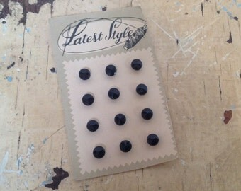 Vintage 'Latest Style' card with 12 black buttons