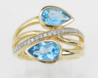 Diamond and Blue Topaz Cocktail Bypass Ring 14K Yellow Gold Size 7 December Gemstone