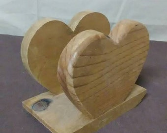 rustic napkin holder in the shape of a heart made out of pine