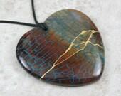 Kintsugi (kintsukuroi) brown agate with blue dragon veins stone heart pendant with gold repair on black cotton cord - OOAK