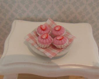 Plate with strawberry cupcakes