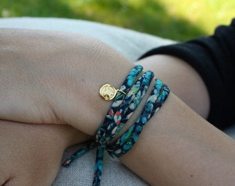 Handcrafted 18k gold lily of the valley pendant on a liberty bracelet or necklace