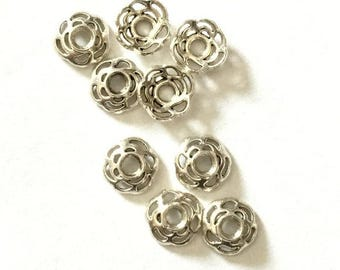 Silver bead caps for Creative jewelry designs.  Handmade jewelry. Jewelry supplies for talented DIY.