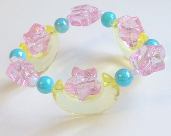 Luna - Transparent Yellow Moon Stretch Bracelet with Pink Glitter Stars and Iridescent Blue Beads