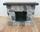 "Doll House Miniature, on a Scale 1:12, ""Stone"" Fireplace, has a, wood mantel, and gray, black and beige stone face with a black brick inset"