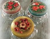 vintage vanity jars / set of 3 / glass jars with painted floral lids / vintage dresser jars / pink blue yellow / roses & poppies