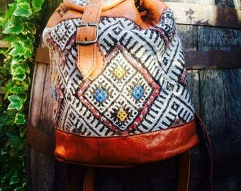 Handmade Moroccan leather rucksack with traditional hand-woven carpet