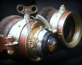 Steampunk goggles in brown leather and brass with amber monocle-style ocular