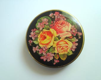 Small vintage floral tin
