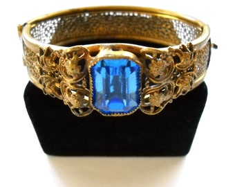 Vintage Art Deco Czech Transitional Bohemian Pierced Floral and Blue Rhinestone Hinged Clamper Bracelet  1920's 1930's