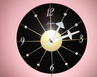 FLYING SAUCER CLOCK by Spartus painted black metal gray numerals and hands early 60s