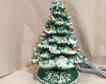 Ceramic Christmas tree 10 inches tall handpainted by Joan Davis comes with snow on it
