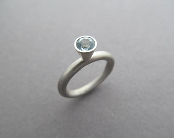 Sterling Silver and Topaz Halo Statement Engagement Ring