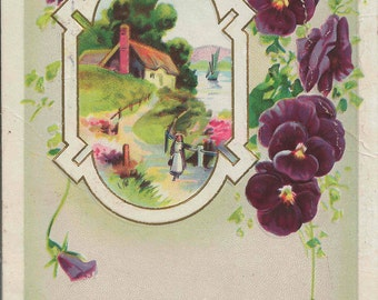 1915 Vintage Best Wishes Postcard Cottage by Lake Surrounded by Purple Pansies