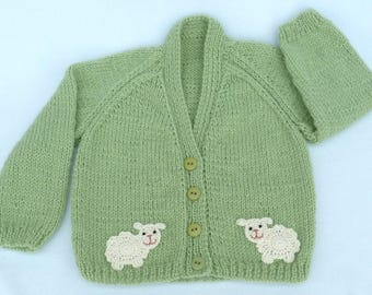 Baby sweater. Hand knitted pale green baby cardigan to fit a 6 to 12 months baby. Baby clothes, baby gift, baby shower.