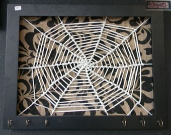 Jewelry holder wood frame white spider web over burlap