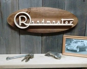 1954 Buick Roadmaster Emblem Oval Wall Plaque-Unique scroll saw automotive art created from wood.