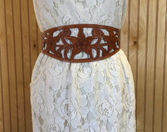 Brown tooled leather cutout belt