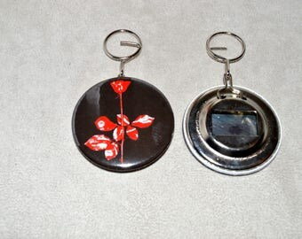 "bottle opener and keychain ""Violator"" the round is 5.8 cm diameter"