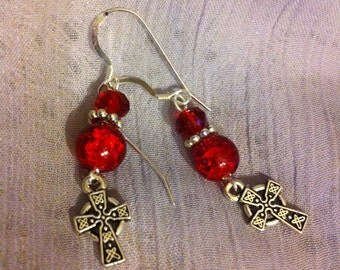 Red and silver pierced earrings with Celtic Cross charms.