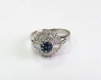 Alexandrite diamond ring in platinum almost 100% color change.