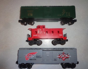 Lionel trains,3 cars in 027,0 gauge from Minnesota,and Minneapolis based Railroads ,or companies