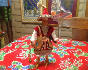 Vintage standing Mongolian folk doll in native garb