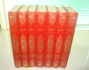 Set of 8 Collette Vinyl covered books by Heron Books.