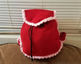 Red backpack with pink ruffles