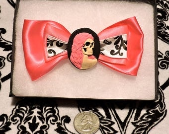 Dark pink bow clip with lg skeleton cameo
