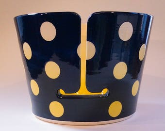 Yarn bowl with yellow polka dots.