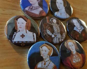 The Six Wives of Henry VIII - a set of 7 25mm button badges featuring the matrimony mad monarch and his many missuses!