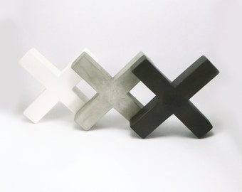 """Bookends of concrete """"X"""" 