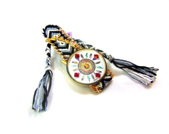 Watch Indian Love in red rhinestone and feather