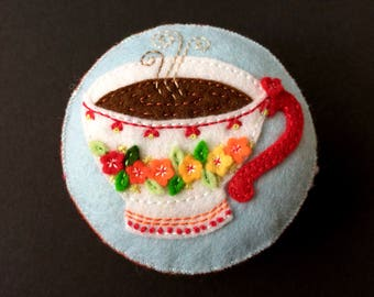 colorful orange and blue wool felt cup pincushion with flowers and hand embroidery