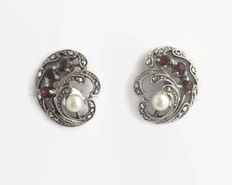 Sterling silver earrings with marcasite, red garnets, and cultured pearls, screw backs, stamped 925, circa 1950s