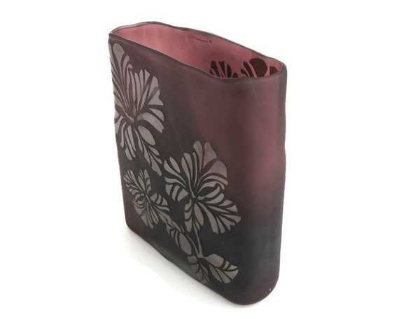 Czech glass vase in dark mushroom color, each side of vase has overlay of chrysanthemum flowers with stencil effect in shiny glass