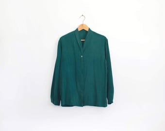 Soft green silky shirt with beautiful dry hand feel