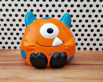 Orange and Teal Monster Piggy Bank